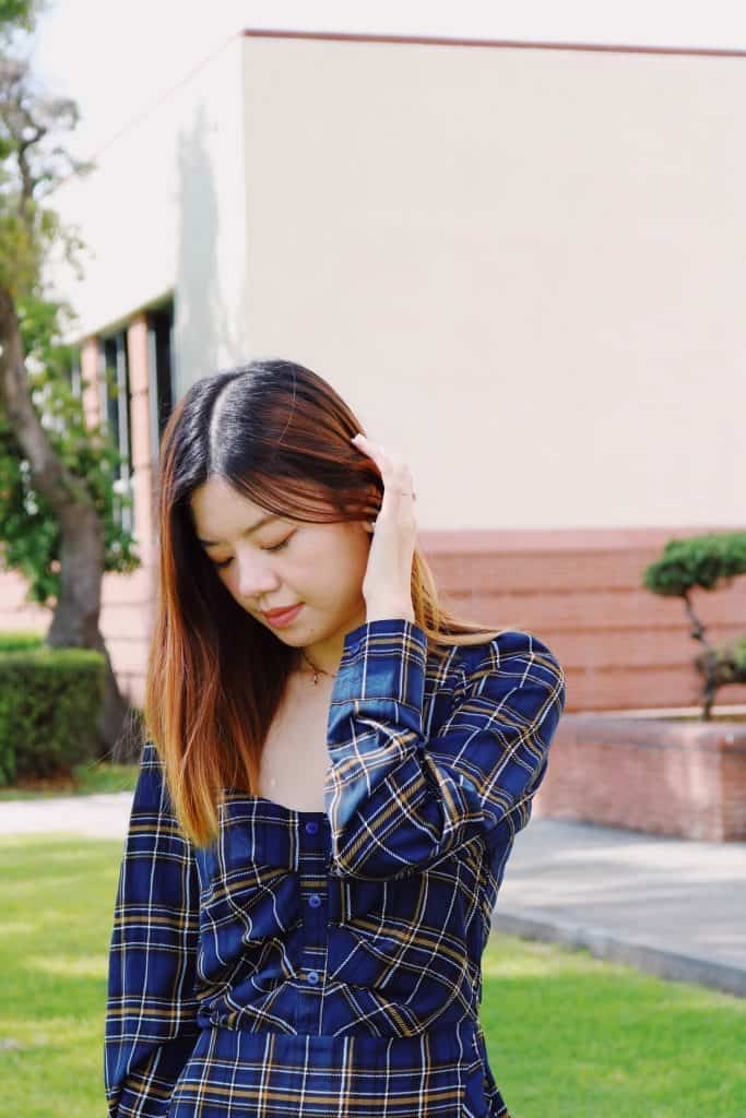 Girl wearing missguided blue plaid dress