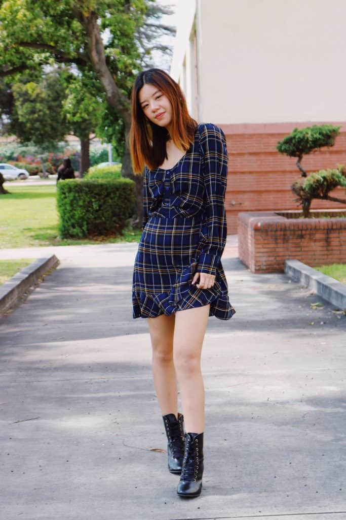 girl wearing missguided blue plaid dress with black boots